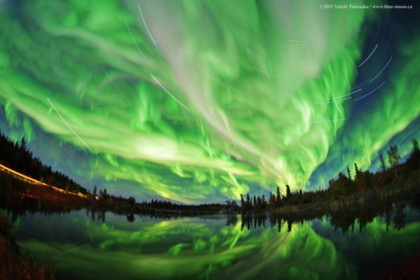 Green swirls of light from the aurora borealis.