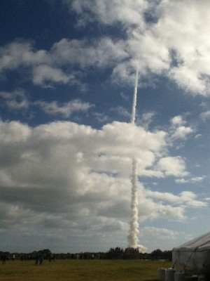 The Atlas V rocket carrying the Mars Science Labratory races through the clouds.