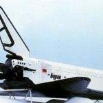 The Buran space shuttle mounted on a plane for transport.