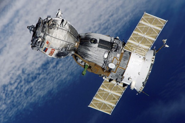 A Russian Soyuz spacecraft in orbit around Earth