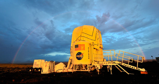 A picture of the NASA Habitat Demonstration Unit at sunset.