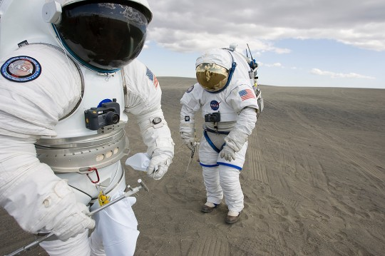Prototypes of NASA's new space suits being tested on Earth.