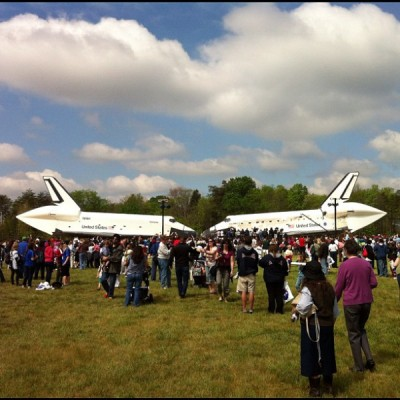 The space shuttles Discovery and Challenger nose to nose at a press event