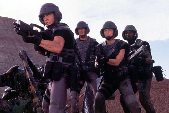 A still from the movie Starship Troopers in which they look ready to fight!